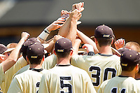 The Wake Forest Demon Deacons huddle up before taking the field against the Georgia Tech Yellow Jackets at Wake Forest Baseball Park on April 15, 2012 in Winston-Salem, North Carolina.  The Demon Deacons defeated the Yellow Jackets 11-3.  (Brian Westerholt/Four Seam Images)