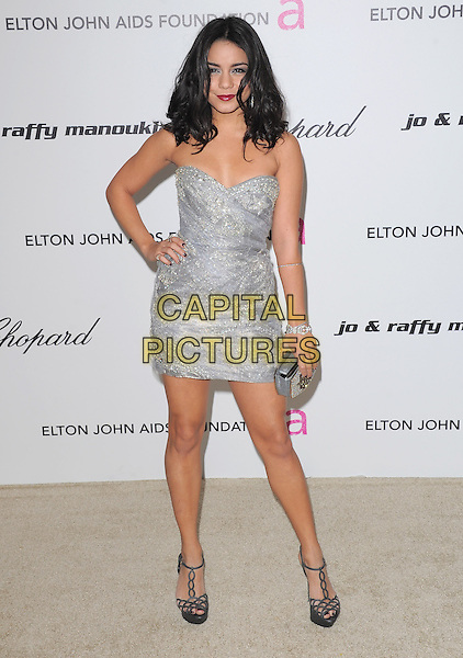 VANESSA HUDGENS.19th Annual Elton John AIDS Foundation Academy Awards Viewing Party held at The Pacific Design Center, West Hollywood, California, USA..February 27th, 2011.full length dress silver strapless dress clutch bag hand on hip.CAP/RKE/DVS.©DVS/RockinExposures/Capital Pictures.