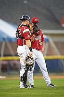 Batavia Muckdogs catcher Alex Jones (55) talks with relief pitcher Shane Sawczak (33) during a game against the Aberdeen Ironbirds on July 14, 2016 at Dwyer Stadium in Batavia, New York.  Aberdeen defeated Batavia 8-2. (Mike Janes/Four Seam Images)
