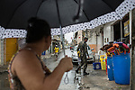 RECIFE, BRAZIL - JANUARY 9: Soldiers working with the Environmental Health Department go door to door encouraging and educating residents about how to clean up standing water, which provides perfect breeding ground for the zika-carrying mosquitoes, in Recife, Pernambuco, Brazil, on Saturday, Jan. 9, 2016<br /> <br /> The mosquito-borne Zika virus continues to spread in Brazil, alarming health officials and expecting mothers that their babies will be born with abnormal brain development called microcephaly. While researchers have yet to make a connection, Brazil has the highest number of babies born with mircocephaly - the most cases in Recife, Pernambuco - from mothers who tested positive to the Zika virus. There are about 3,530 suspected cases of zika-related microcephaly in Brazil.