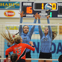 NWA Democrat-Gazette/ANDY SHUPE<br /> Elleson Dunagin (13) of Rogers Heritage sends the ball over the net as Paige Williams (21) and Emily Thompson (23) of Springdale Har-Ber reach to block Thursday, Sept. 17, 2015, at Wildcat Arena in Springdale. Visit nwadg.com/photos to see more photographs from the game.