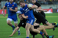 France's Pierre Bourgarit bumps off NZ's Nathan Harris during the Steinlager Series international rugby match between the New Zealand All Blacks and France at Westpac Stadium in Wellington, New Zealand on Saturday, 16 June 2018. Photo: Dave Lintott / lintottphoto.co.nz
