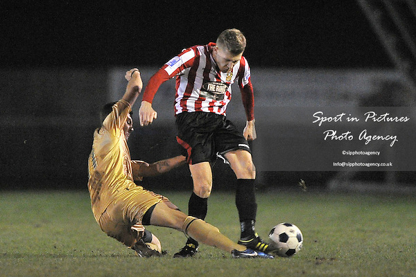Lewis Smith (Hornchurch) is tackled by George Porter (Colchester). AFC Hornchurch Vs Colchester United. Essex Senior Cup. Fifth (5th) Round.The Stadium. Essex. 08/01/2013. MANDATORY Credit Garry Bowden/Sportinpictures - NO UNAUTHORISED USE - 07837 394578