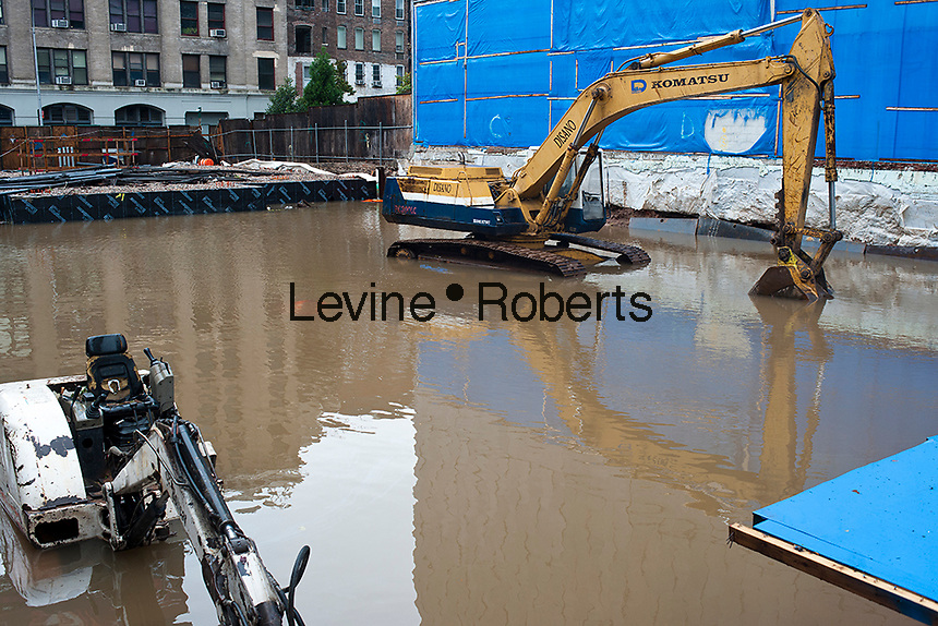 A flooded construction site in the New York neighborhood of Hudson Square from flooding from Hurricane Sandy is seen on Tuesday, October 30, 2012. Hurricane Sandy roared into New York disrupting the transit system and causing widespread power outages. Con Edison is estimating it will take four days to get electricity back to Lower Manhattan. (© Richard B. Levine)