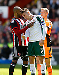 Angus MacDonald of Barnsley head butts Leon Clarke of Sheffield Utdduring the Championship League match at Bramall Lane Stadium, Sheffield. Picture date 19th August 2017. Picture credit should read: Simon Bellis/Sportimage
