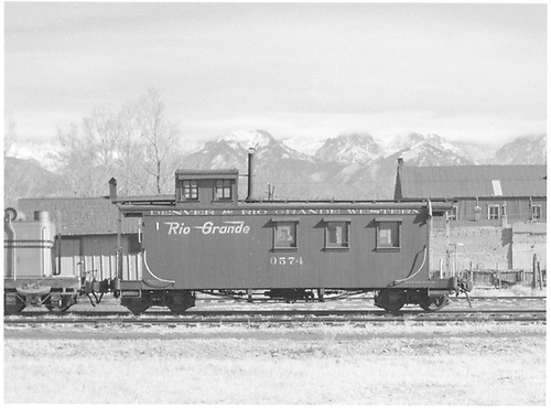 Long caboose #0574 in Moffat, CO.<br /> D&amp;RGW  Moffat, CO  Taken by Richardson, Robert W. - 12/3/1950