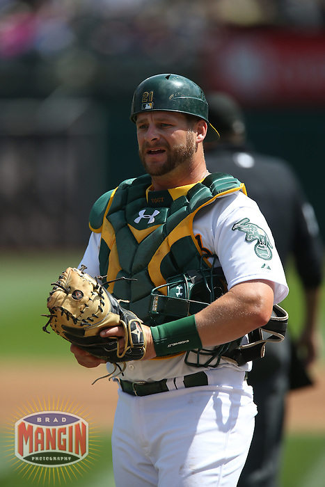 OAKLAND, CA - APRIL 9:  Stephen Vogt #21 of the Oakland Athletics works behind the plate against the Texas Rangers during the game at O.co Coliseum on Thursday, April 9, 2015 in Oakland, California. Photo by Brad Mangin