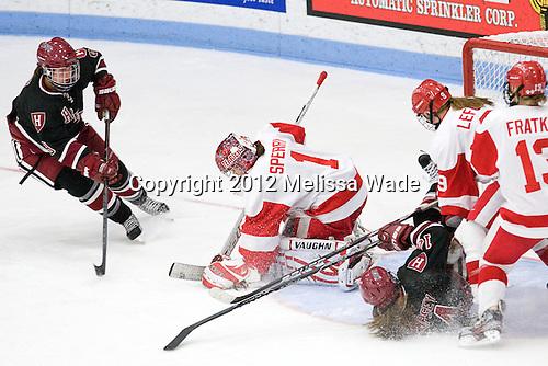 Lyndsey Fry (Harvard - 9), Kerrin Sperry (BU - 1), Jillian Dempsey (Harvard - 14), Sarah Lefort (BU - 9) - The Boston University Terriers defeated the visiting Harvard University Crimson 2-1 on Sunday, November 18, 2012, at Walter Brown Arena in Boston, Massachusetts.