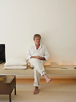 Portrait of architect John Pawson sitting in the living room of his London home