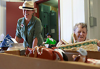 NWA Democrat-Gazette/CHARLIE KAIJO Volunteers, Lena Lewis of Bentonville and Marlene Sands of Cave Springs (from left) help check-in vendors, Saturday, August 4, 2018 at the Benton County Fairgrounds in Bentonville. <br />