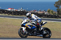 Marco Melandri (ITA) riding the BMW S1000 RR HP4 (33) of the BMW Motorrad GoldBet SBK Team exits turn 10 during a practise session on day two of round one of the 2013 FIM World Superbike Championship at Phillip Island, Australia. rounds turn 11 during a practise session on day two of round one of the 2013 FIM World Superbike Championship at Phillip Island, Australia.