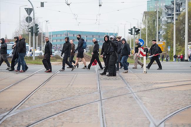 Ca. 1000 Nazis aus ganz Deutschland marschierten am Sonntag den 1. Mai 2016 im Saeschsichen Plauen auf. Die Naziorganisation 3.Weg hatte den Marsch angemeldet. Etliche Nazis waren dabei vermummt und zeigten auch den Hitlergruss, die Polizei schritt jedoch nicht ein.<br /> Nach der Haelfte der Marschroute beendeten die Nazis ihre Demonstration, da die Polizei die Marschroute verkuerzen wollte. Sie forderten die Polizei auf den Weg freizugeben. Danach griffen Aufmarschteilnehmer die Polizei an, die daraufhin Wasserwerfer, Pfefferspray, Traenengas und Schlagstoecke einsetzte. Mehrere Gruppen Nazis zogen danach durch Plauen und jagten Menschen.<br /> Nach einer Stunde bekamen die Nazis einen erneuten Aufmarsch von der Polizei genehmigt und zogen zurueck zum Bahnhof.<br /> Im Bild: Eine der Nazi-Gruppen, die durch Plauen zogen und ungehindert Jagd auf vermeindliche Gegner und Journalisten machen konnten.<br /> 1.5.2016, Plauen<br /> Copyright: Christian-Ditsch.de<br /> [Inhaltsveraendernde Manipulation des Fotos nur nach ausdruecklicher Genehmigung des Fotografen. Vereinbarungen ueber Abtretung von Persoenlichkeitsrechten/Model Release der abgebildeten Person/Personen liegen nicht vor. NO MODEL RELEASE! Nur fuer Redaktionelle Zwecke. Don't publish without copyright Christian-Ditsch.de, Veroeffentlichung nur mit Fotografennennung, sowie gegen Honorar, MwSt. und Beleg. Konto: I N G - D i B a, IBAN DE58500105175400192269, BIC INGDDEFFXXX, Kontakt: post@christian-ditsch.de<br /> Bei der Bearbeitung der Dateiinformationen darf die Urheberkennzeichnung in den EXIF- und  IPTC-Daten nicht entfernt werden, diese sind in digitalen Medien nach &sect;95c UrhG rechtlich geschuetzt. Der Urhebervermerk wird gemaess &sect;13 UrhG verlangt.]