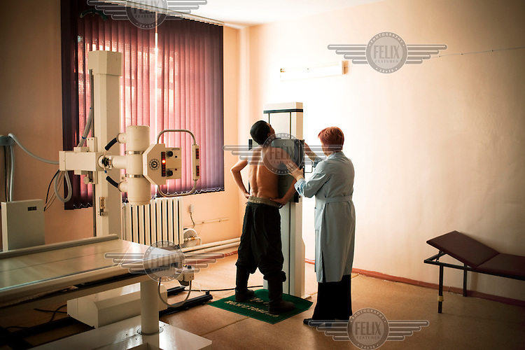 A detainee at Specialised Prison Colony 27 who has MDR TB (multi-drug-resistant tuberculosis) is X-rayed by a doctor. Kyrgyzstan's prisons are experiencing a TB epidemic, where the incidence rate is estimated at 25 times higher than in civil society.