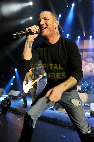 STONE SOUR - Corey Taylor.Performing live at the Hammersmith Apollo, London, England..October 30th, 2010.stage concert live gig performance music full length jeans denim ripped top black top singing  3/4 half.CAP/MAR.© Martin Harris/Capital Pictures.