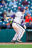 Derek Odell #5 of the Texas Christian Horned Frogs follows through on his swing against the Sam Houston State Bearkats at Minute Maid Park on February 28, 2014 in Houston, Texas.  The Bearkats defeated the Horned Frogs 9-4.  (Brian Westerholt/Four Seam Images)