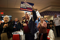 People listen as Senator Scott Brown (R-MA) speaks to a crowd gathered the VFW Post 88 for a campaign stop in North Billerica, Massachusetts, USA, on Thurs., Nov. 2, 2012. Senator Scott Brown is seeking re-election to the Senate.  His opponent is Elizabeth Warren, a democrat.
