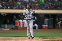 OAKLAND, CA - JUNE 14:  Mac Williamson #12 of the Seattle Mariners reacts after striking out against the Oakland Athletics during the game at the Oakland Coliseum on Friday, June 14, 2019 in Oakland, California. (Photo by Brad Mangin)