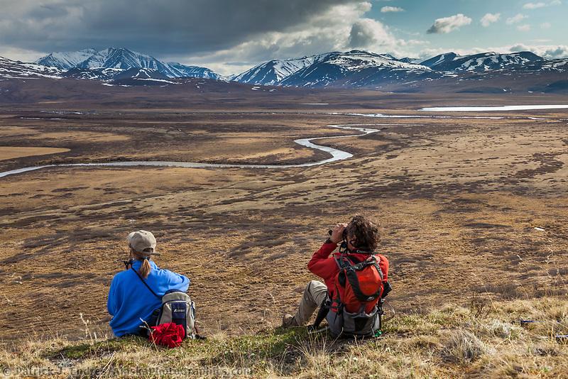 Hikers enjoy view of the Nigu river, Brooks range, Gates of the Arctic National Park, Alaska.