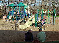 Children play on the playground Greenleaf park in Charlottesville, VA. Photo/Andrew Shurtleff