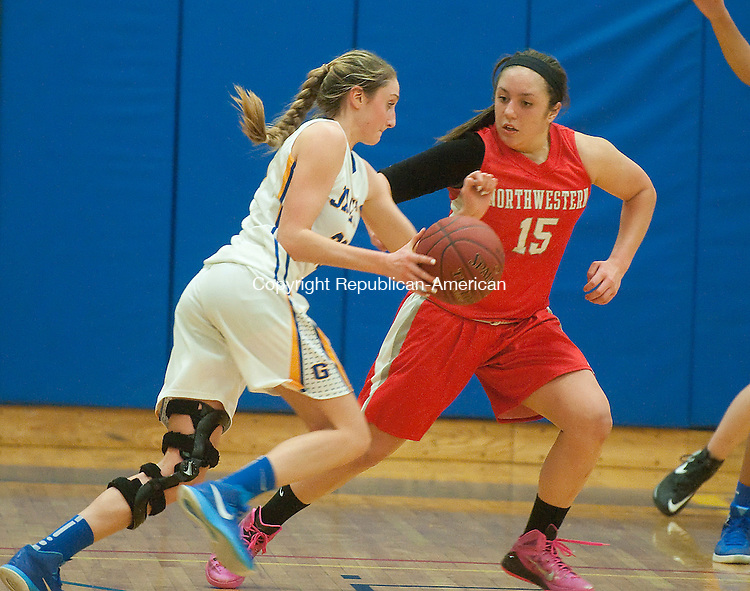 WINSTED, CT--- -011516JS04--Gilbert's Ali Brochu (32) drives to the basket begging defended by Northwestern's Gina Weingart (15)  during their game Friday at the Gilbert School in Winsted. <br />  Jim Shannon Republican-American
