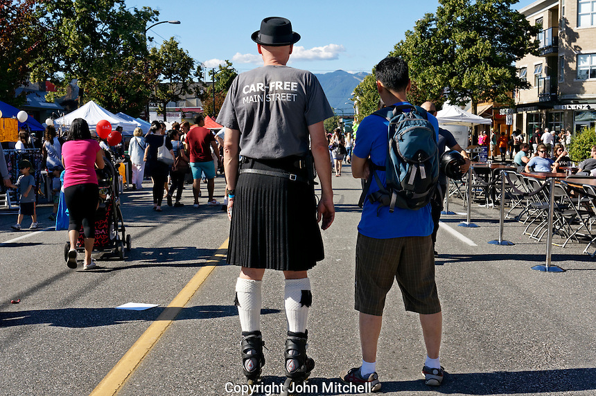 VANCOUVER, CANADA, 21st June, 2015. A rollerblader takes in the scene at the annual Car Free Day Festival on Main Street in Vancouver, British Columbia. This year marks the 11th anniversary of this arts and culture festival aimed at reclaiming city streets as car-free public spaces.