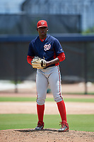 GCL Nationals relief pitcher Rodney Theophile (38) gets ready to deliver a pitch during a game against the GCL Astros on August 6, 2018 at FITTEAM Ballpark of the Palm Beaches in West Palm Beach, Florida.  GCL Astros defeated GCL Nationals 3-0.  (Mike Janes/Four Seam Images)