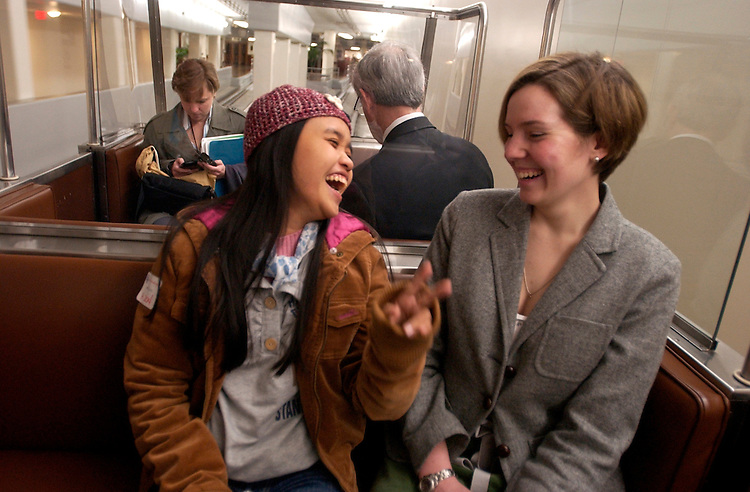 Thuy Anh, left, a student sponsored by Chief of Staff for Rep. Bart Gordon, D-Tenn., shares a laugh with staffer Katie Dawson on the subway from Rayburn before a Capitol tour.