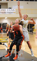 NWA Democrat-Gazette/ANDY SHUPE<br /> Kyrstin Branscum (3) of Gravette attempts a shot in the lane as Ashley Brannon of Pottsville defends Wednesday, Feb. 24, 2016, during the first half of play in the 4A North Regional Tournament in Tiger Arena in Prairie Grove. Visit nwadg.com/photos to see more photographs from the game.