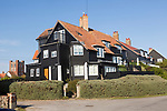 Historic clapperboard houses in village of Thorpeness, Suffolk, England, UK