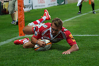 20130801 Copyright onEdition 2013 ©<br />Free for editorial use image, please credit: onEdition.<br /><br />Martyn Thomas of Gloucester Rugby 7s scores a try  during the J.P. Morgan Asset Management Premiership Rugby 7s Series.<br /><br />The J.P. Morgan Asset Management Premiership Rugby 7s Series kicks off for the fourth season on Thursday 1st August with Pool A at Kingsholm, Gloucester with Pool B being played at Franklin's Gardens, Northampton on Friday 2nd August, Pool C at Allianz Park, Saracens home ground, on Saturday 3rd August and the Final being played at The Recreation Ground, Bath on Friday 9th August. The innovative tournament, which involves all 12 Premiership Rugby clubs, offers a fantastic platform for some of the country's finest young athletes to be exposed to the excitement, pressures and skills required to compete at an elite level.<br /><br />The 12 Premiership Rugby clubs are divided into three groups for the tournament, with the winner and runner up of each regional event going through to the Final. There are six games each evening, with each match consisting of two 7 minute halves with a 2 minute break at half time.<br /><br />For additional images please go to: http://www.w-w-i.com/jp_morgan_premiership_sevens/<br /><br />For press contacts contact: Beth Begg at brandRapport on D: +44 (0)20 7932 5813 M: +44 (0)7900 88231 E: BBegg@brand-rapport.com<br /><br />If you require a higher resolution image or you have any other onEdition photographic enquiries, please contact onEdition on 0845 900 2 900 or email info@onEdition.com<br />This image is copyright the onEdition 2013©.<br /><br />This image has been supplied by onEdition and must be credited onEdition. The author is asserting his full Moral rights in relation to the publication of this image. Rights for onward transmission of any image or file is not granted or implied. Changing or deleting Copyright information is illegal as specified in the Copyright, Design and Patents Act 1988. If yo