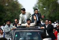 President Mahmoud Ahmadinejad waves from his armoured Nissan jeep with gun-carrying bodyguards hanging on to all sides of the car, as he is driven to deliver a speech in the central Iranian town of Isfahan (Esfahan). On each trip he makes, Mr Ahmadinejad is accompanied by up to 100 bodyguards as he claims that Western intelligence organizations are planning to assassinate him....