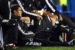 Injured New Zealand first-five Dan Carter sits with the reserves during the first international rugby test at Eden Park, Auckland, New Zealand, Saturday, June 02, 2007. The All Blacks beat France 42-11.