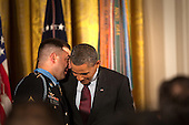 Sergeant First Class Leroy Arthur Petry, U.S. Army, whispers to U.S. President Barack Obama after receiving from him the Medal of Honor for conspicuous gallantry and intrepidity at the risk of his life above and beyond the call of duty in the East Room of the White House in Washington D.C., July 12, 2011.  Sergeant Petry is receiving the medal for his courageous actions during combat operations against an armed enemy in Paktya, Afghanistan in May, 2008 and is the second living, active duty service member to be awarded the Medal of Honor for actions in Iraq or Afghanistan. .Credit: Allison Shelley / Pool via CNP