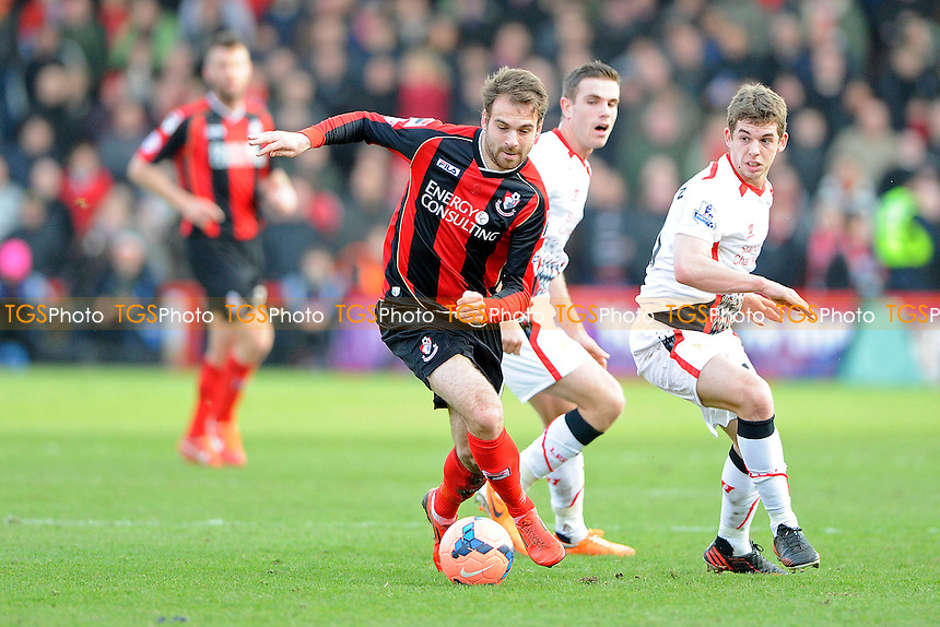 Brett Pitman of AFC Bournemouth gets away from Jon Flanagan of Liverpool - AFC Bournemouth vs Liverpool - FA Cup 4th Round Football at the Goldsands Stadium, Bournemouth, Dorset - 25/01/14 - MANDATORY CREDIT: Denis Murphy/TGSPHOTO - Self billing applies where appropriate - 0845 094 6026 - contact@tgsphoto.co.uk - NO UNPAID USE