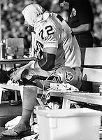 Raider John Matuszak sitting on bench during the 1977 Superbowl game against the Minnesota Vikings..<br />(photo/Ron Riesterer)