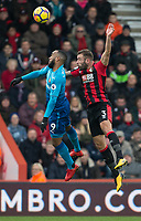 Alexandre Lacazette of Arsenal & Steve Cook of AFC Bournemouth during the Premier League match between Bournemouth and Arsenal at the Goldsands Stadium, Bournemouth, England on 14 January 2018. Photo by Andy Rowland.