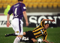 Phoenix' Leo Bertos is brought down by Adriano Pellegrino to earn the free kick from which he scored the winning goal during the A-League football match between Wellington Phoenix and Perth Glory at Westpac Stadium, Wellington, New Zealand on Sunday, 16 August 2009. Photo: Dave Lintott / lintottphoto.co.nz