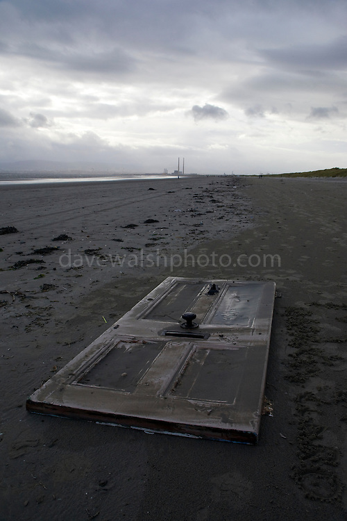 Discarded door on Dollymount strand, Bull Island, Dublin. ..Bull Island is a UNESCO protected biosphere reserve in the Northern suburbs of Dublin. It features two golf clubs, and Dollymount beach, used for kitesurfing and other outdoor activities. Wildlife includes seals and bird life.