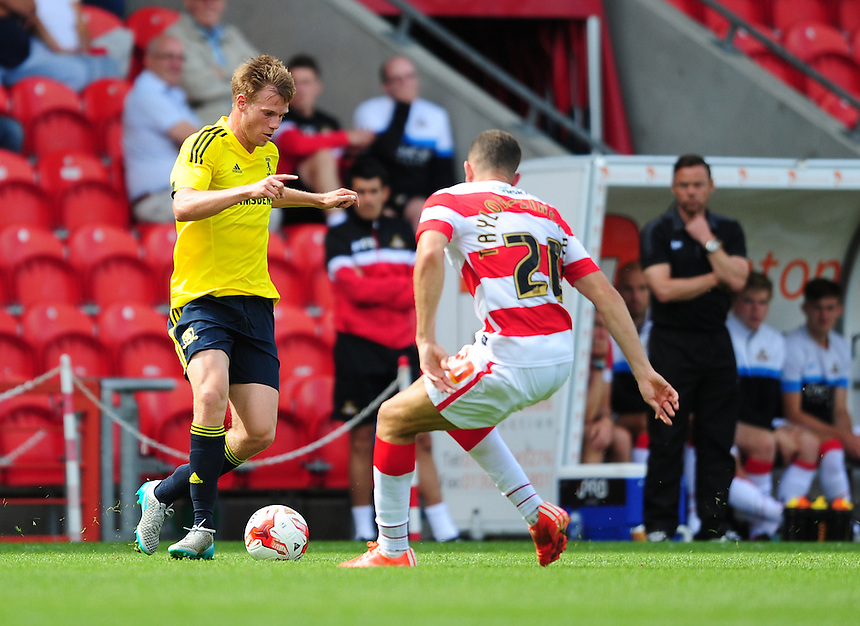 Middlesbrough's Tomas Kalas vies for possession with Doncaster Rovers&rsquo; Aaron Taylor-Sinclair<br /> <br /> Photographer Chris Vaughan/CameraSport<br /> <br /> Football - Pre-Season Friendly - Doncaster Rovers v Middlesbrough - Saturday 25th July 2015 - Keepmoat Stadium, Doncaster<br /> <br /> &copy; CameraSport - 43 Linden Ave. Countesthorpe. Leicester. England. LE8 5PG - Tel: +44 (0) 116 277 4147 - admin@camerasport.com - www.camerasport.com