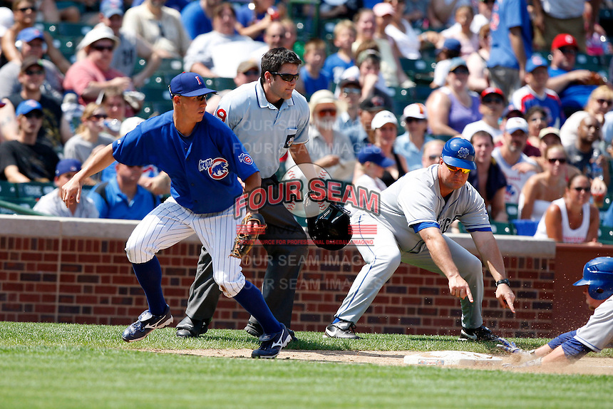 August 9, 2009:  Third Baseman Matt Craig of the Iowa Cubs chases down a throw as Coach Mike Basso tells Aaron Mathews to get down and umpire Will Robinson looks on during a game at Wrigley Field in Chicago, IL.  Iowa is the Pacific Coast League Triple-A affiliate of the Chicago Cubs.  Photo By Mike Janes/Four Seam Images