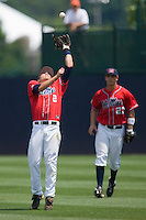 Second baseman Alex Yarbrough #2 of the Ole Miss Rebels catches a fly ball in shallow right field against the St. John's Red Storm at the Charlottesville Regional of the 2010 College World Series at Davenport Field on June 6, 2010, in Charlottesville, Virginia.  The Red Storm defeated the Rebels 20-16.  Photo by Brian Westerholt / Four Seam Images