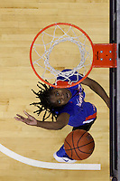 SEATTLE, WA - DECEMBER 18: Savannah State's #3 Taylor-Ashley Shaw goes up for a basket against Washington.  Washington won 87-36 over Savannah State at Alaska Airlines Arena in Seattle, WA.