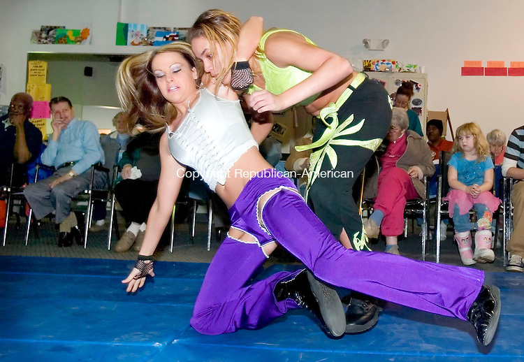WATERBURY, CT. 22 January 2007--012207SV13--WWE divas Mercedes Martinez of Waterbury and Talia Madison of Waterbury wrestle during a show at Daybreak, an adult day care, in Waterbury Monday. Steven Valenti Republican-American