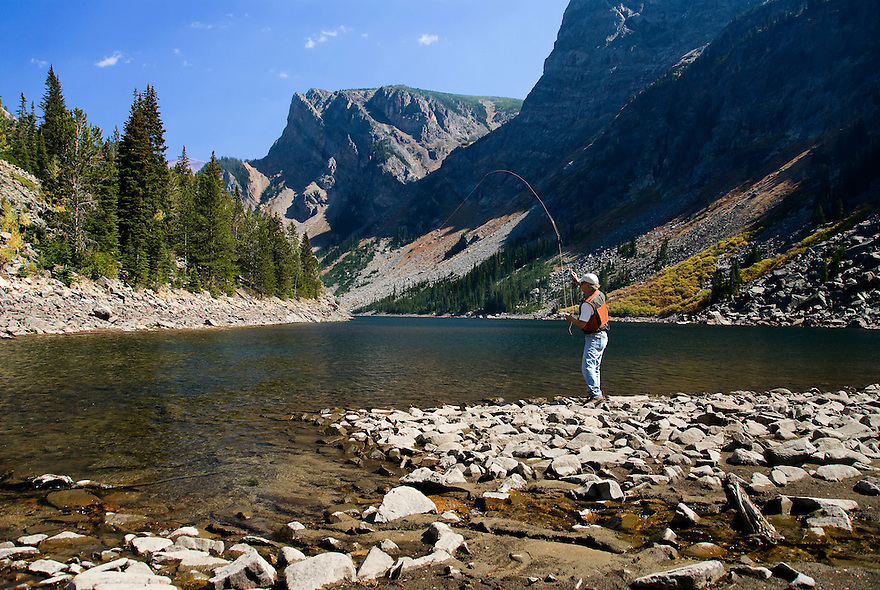 An angler cast for Yellowstone cutthroat trout at Lake at the Falls in the Absaroka-Beartooth Wilderness.