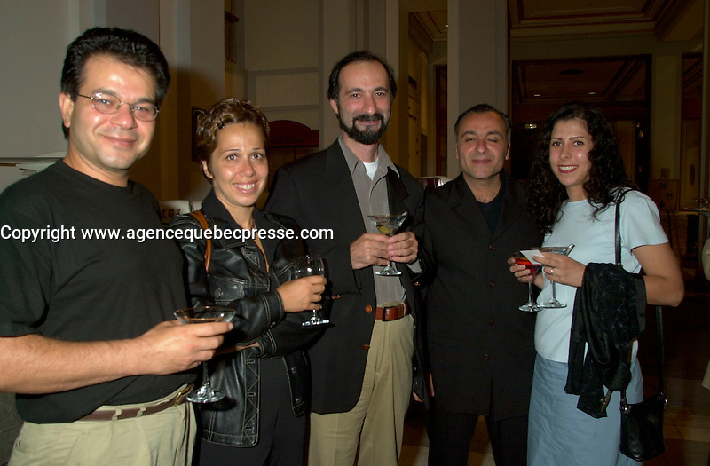 Sept 2, 2002, Montreal, Quebec, Canada<br /> <br /> Tayfun Pirselomoglu (center) pose with a group after he received a Special Grand Prix of the Jury  for his film HICBIRYEDE (INNOWHERE LAND),at the closing ceremony of the 2002 Montreal World Films Festival, Sept 2 2002, in  Montreal, Quebec, Canada<br /> <br /> <br /> Mandatory Credit: Photo by Pierre Roussel- Images Distribution. (&copy;) Copyright 2002 by Pierre Roussel <br /> <br /> NOTE : <br />  Nikon D-1 jpeg opened with Qimage icc profile, saved in Adobe 1998 RGB<br /> .Uncompressed  Uncropped  Original  size  file availble on request.
