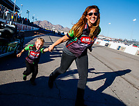 Oct 29, 2017; Las Vegas, NV, USA; Cori McMillen, wife of NHRA top fuel driver Terry McMillen celebrates with son Cameron McMillen after winning the Toyota National at The Strip at Las Vegas Motor Speedway. Mandatory Credit: Mark J. Rebilas-USA TODAY Sports