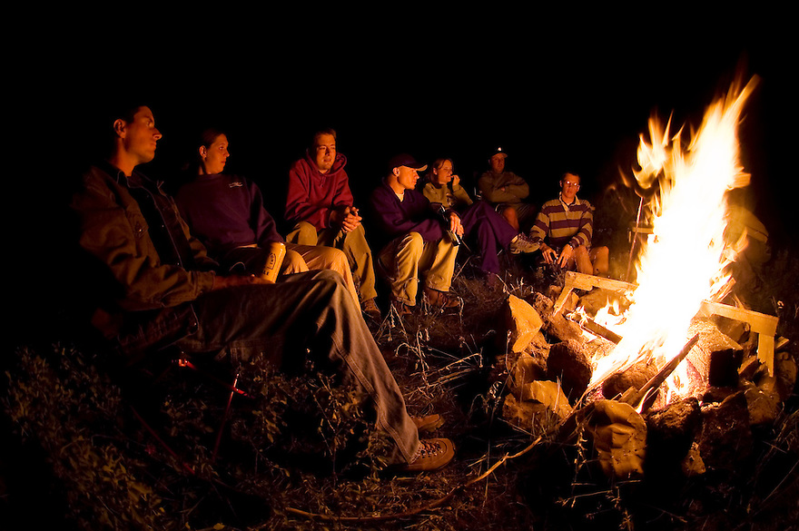 Campers gather around a fire in the Gallatin Mountain Range near Big Sky, Montana.