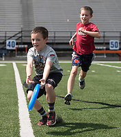 NWA Democrat-Gazette/ANTHONY REYES @NWATONYR<br /> Brothers Ethan McCrary, 10, and Jacob McCrary, 9, chase a flying disc Tuesday, March 21, 2017 while playing with their older brother and other friends at David Gates Stadium in Rogers. The group was enjoying the nice weather during their spring break vacation.