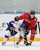 Robin Grossmann (Kloten Flyers - Switzerland) defends against Julius Sinkovic (Val-d'Or - Slovakia). The Suisse defeated Slovakia 2-1 in a 2007 World Juniors match on January 2, 2007, at FM Mattson Arena in Mora, Sweden.