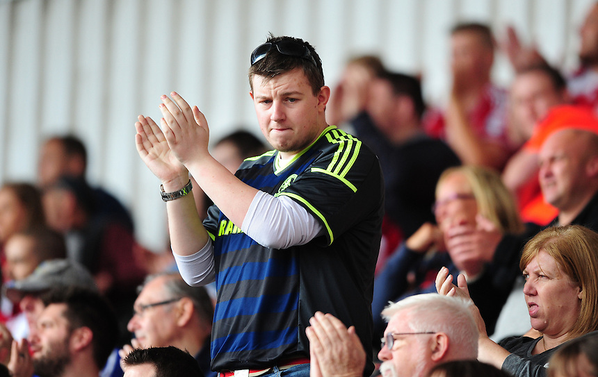 Middlesbrough fans during the second half<br /> <br /> Photographer Chris Vaughan/CameraSport<br /> <br /> Football - Pre-Season Friendly - Doncaster Rovers v Middlesbrough - Saturday 25th July 2015 - Keepmoat Stadium, Doncaster<br /> <br /> &copy; CameraSport - 43 Linden Ave. Countesthorpe. Leicester. England. LE8 5PG - Tel: +44 (0) 116 277 4147 - admin@camerasport.com - www.camerasport.com